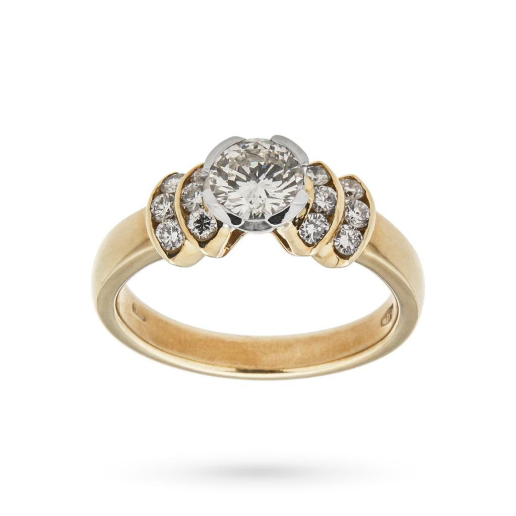 Anello solitario in oro giallo con diamante e contorno - CICALA